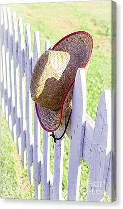 Cowboy Hat On Picket Fence Canvas Print by Edward Fielding