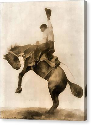 Cowboy On Bucking Bronco Canvas Print by Dan Sproul