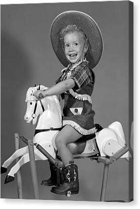 Cowgirl On Rocking Horse, C.1950s Canvas Print by B. Taylor/ClassicStock