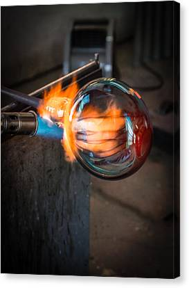 Creation At The Glass Blowers Bench Canvas Print by Rob Travis