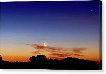 Crescent Moon And Jupiter Canvas Print by Luis Argerich