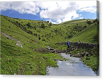 Crossing The Stream In Cressbrook Dale Canvas Print by Rod Johnson
