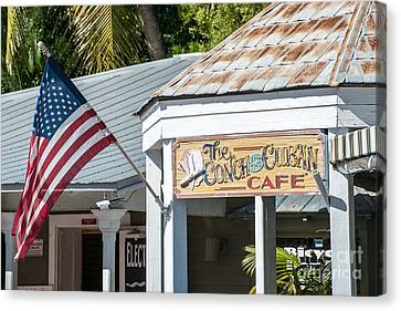 Cuban Cafe And American Flag Key West Canvas Print by Ian Monk