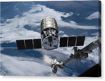 Cygnus Cargo Spacecraft Docking With Iss Canvas Print by Nasa