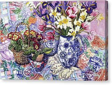Daffodils Tulips And Iris In A Jacobean Blue And White Jug With Sanderson Fabric And Primroses Canvas Print by Joan Thewsey