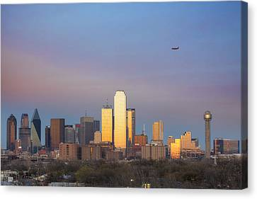Dallas Skyline In The Evening With Southwest Airlines Jet Canvas Print by Rob Greebon
