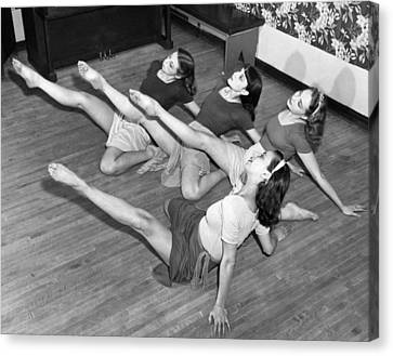 Dancers Warmup Exercises Canvas Print by Underwood Archives