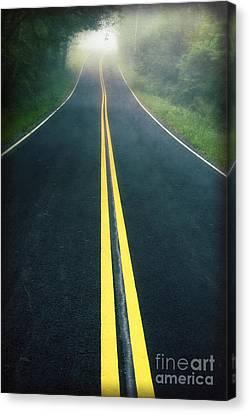 Dark Foggy Country Road Canvas Print by Edward Fielding
