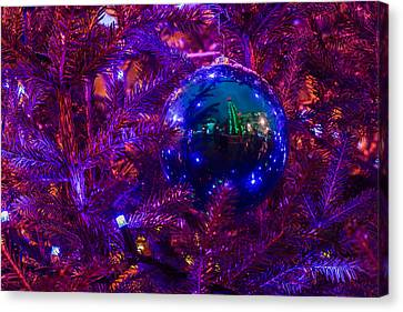 Decoration Ball On A Christmas Tree Illuminated With Red Light - Featured 3 Canvas Print by Alexander Senin