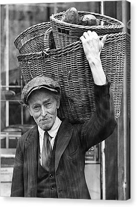 Delivering Baskets Of Bread Canvas Print by Underwood Archives