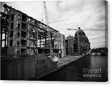 demolition of the Palast der Republik on the bank of the river Spree with the Berliner Dom in the background Berlin Germany Canvas Print by Joe Fox