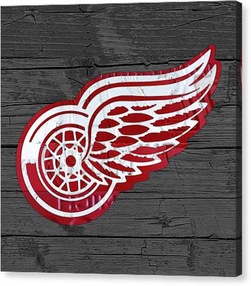 Detroit Red Wings Recycled Vintage Michigan License Plate Fan Art On Distressed Wood Canvas Print by Design Turnpike