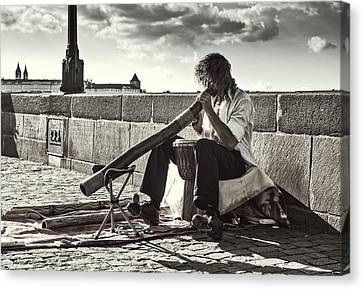 Didgeridoo Player On The Charles Bridge. Prague Canvas Print by Jenny Rainbow