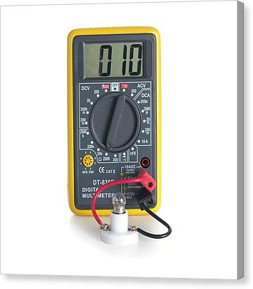 Digital Multimeter With Lightbulb Canvas Print by Science Photo Library