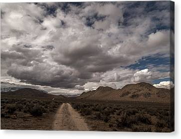Dirt Road And Clouds Canvas Print by Cat Connor
