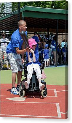 Disabled Girl Playing Baseball Canvas Print by Jim West