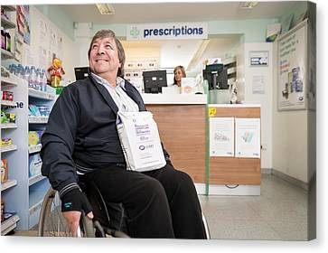 Disabled Man In Pharmacy Canvas Print by Jim Varney