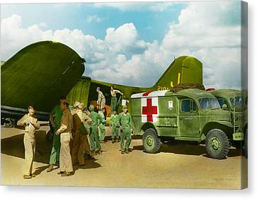 Doctor  - Transferring The Wounded Canvas Print by Mike Savad