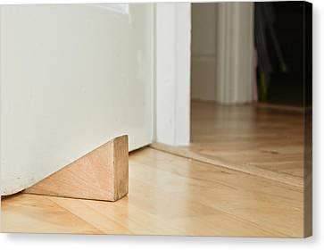 Door Stopper Canvas Print by Tom Gowanlock