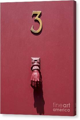 Doorknocker And Number Three On A Red Door. France. Europe. Canvas Print by Bernard Jaubert