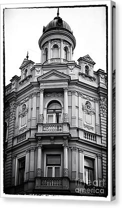 Double Balconies In Prague Canvas Print by John Rizzuto