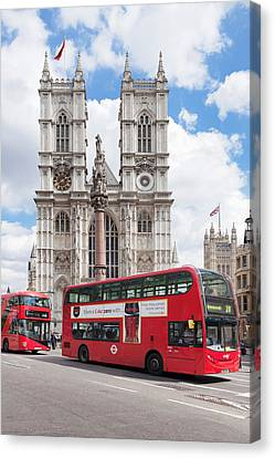 Double-decker Buses Passing Canvas Print by Panoramic Images