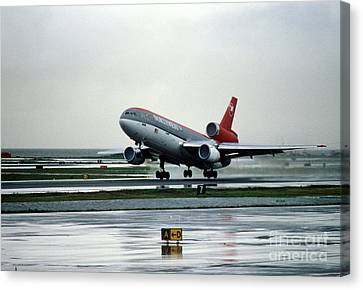 Douglas Dc-10-40 Taking Off In The Rain Canvas Print by Wernher Krutein