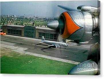 Douglas Dc-7 Taking Off Canvas Print by Wernher Krutein