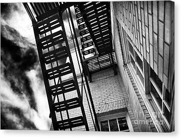Down The Fire Escape Canvas Print by John Rizzuto