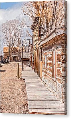 Down The Street Canvas Print by Sue Smith