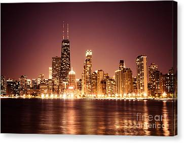 Downtown Skyline At Night Of Chicago Canvas Print by Paul Velgos