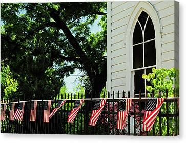 Draped Flags On Fence Of Church, July Canvas Print by Michel Hersen