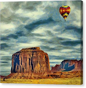 Drifting Over Monument Valley Canvas Print by Jeff Kolker