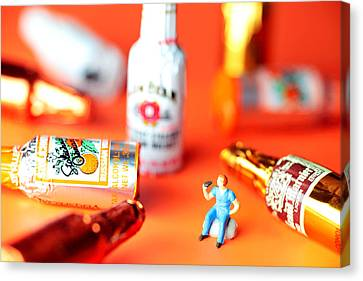 Drinking Among Liquor Filled Chocolate Bottles Canvas Print by Paul Ge