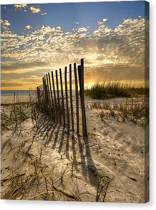 Dune Fence At Sunrise Canvas Print by Debra and Dave Vanderlaan