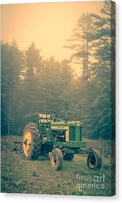 Early Morning Tractor In Farm Field Canvas Print by Edward Fielding