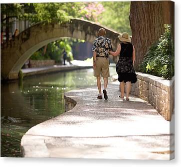 Elderly Couple On Riverwalk Canvas Print by Samuel Kessler