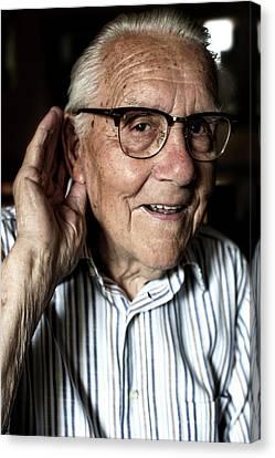 Elderly Man With Hearing Loss Canvas Print by Mauro Fermariello