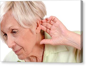 Elderly Woman With Hearing Loss Canvas Print by Aj Photo