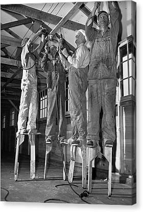 Electricians On Stilts Canvas Print by Underwood Archives