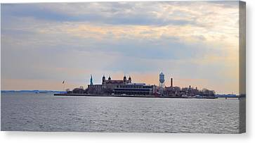 Ellis Island With The Statue Of Liberty Canvas Print by Bill Cannon