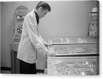 Elvis Presley Playing Pinball 1956 Canvas Print by The Phillip Harrington Collection