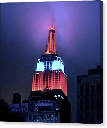 Empire State Building At Night Canvas Print by Michael Dagostino