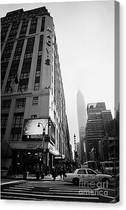 Empire State Building Shrouded In Mist As Pedestrians Crossing Crosswalk On 7th Ave New York Canvas Print by Joe Fox