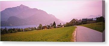 Empty Road Running Through A Town Canvas Print by Panoramic Images
