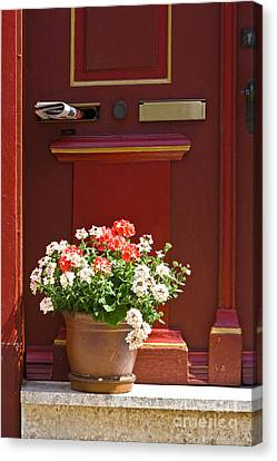 Entrance Door With Flowers Canvas Print by Heiko Koehrer-Wagner