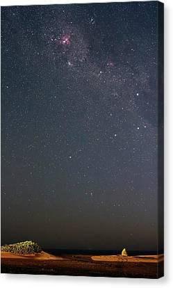 Eta Carina Nebula Over A Beach Canvas Print by Luis Argerich