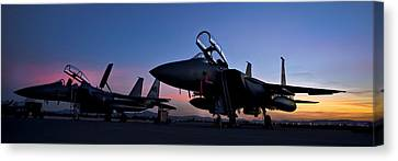 F-15e Strike Eagles At Dusk Canvas Print by Adam Romanowicz