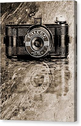 Falcon Miniature Camera With Water Canvas Print by Jon Woodhams