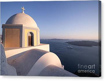 Famous Orthodox Church In Santorini Greece At Sunset Canvas Print by Matteo Colombo